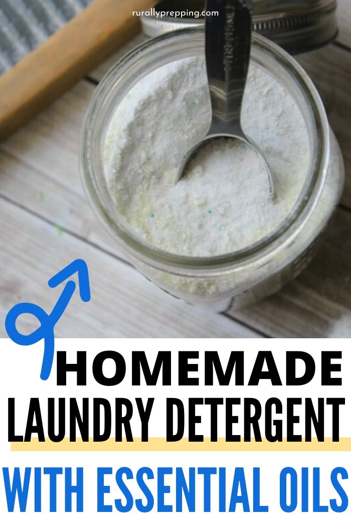 powder homemade laundry detergent in a mason jar with a small metal scoop in it text at the bottom of the image says homemade laundry detergent with essential oils